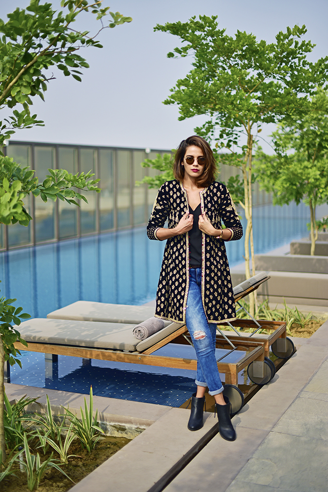 Aditi Somani | Akanksha Redhu | full front holding jacket both hands