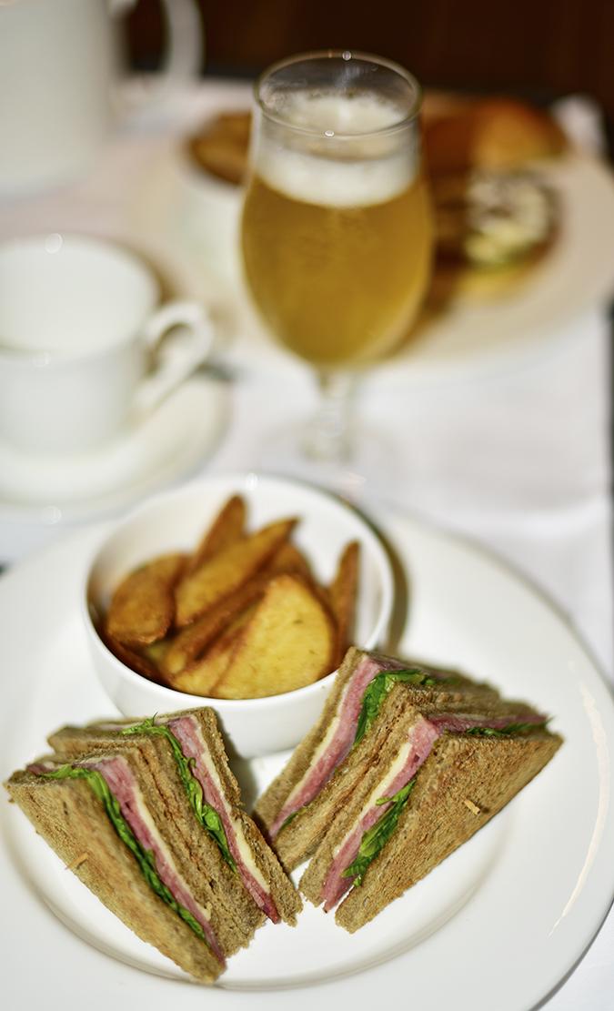 Roseate House | Akanksha Redhu | ham sandwich and beer
