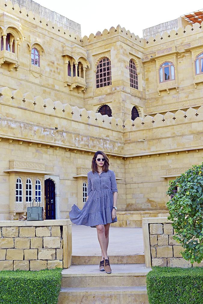 Suryagarh Jaisalmer | Akanksha Redhu | full front check dress wallscape in back
