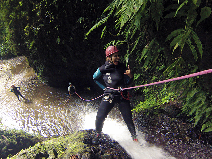 Canyoning in Bali | Akanksha Redhu | me handsign on waterfall