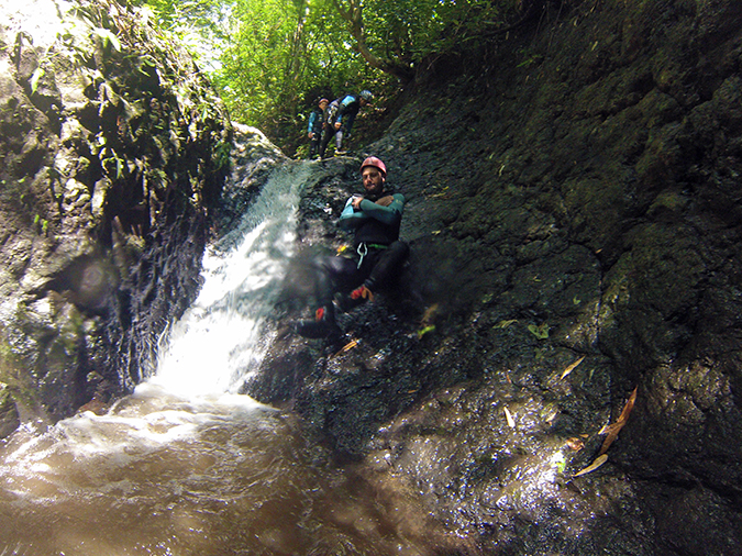 Canyoning in Bali | Akanksha Redhu | aman sliding down rock