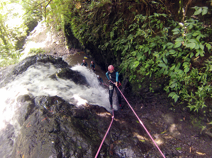 Canyoning in Bali | Akanksha Redhu | me rapelling down waterfall