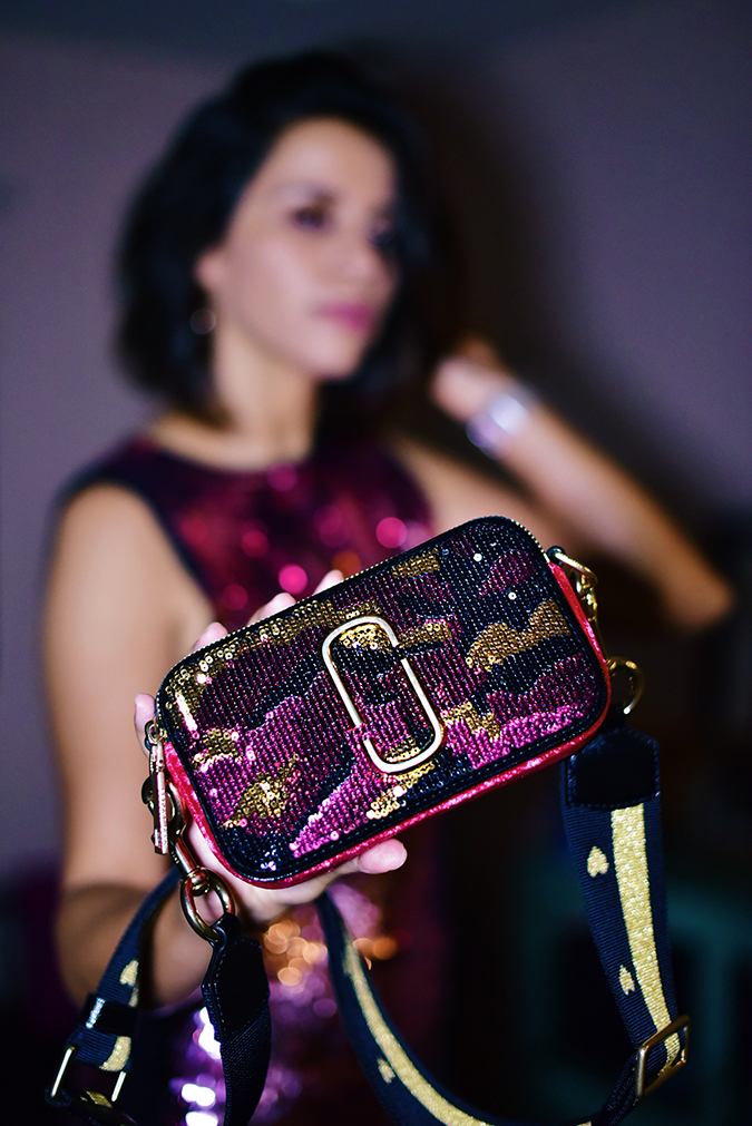 Akanksha Redhu | NYE | bag closeup standing blurred