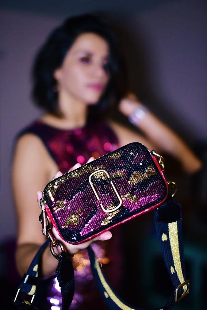 Akanksha Redhu | NYE | bag closeup standing blurred