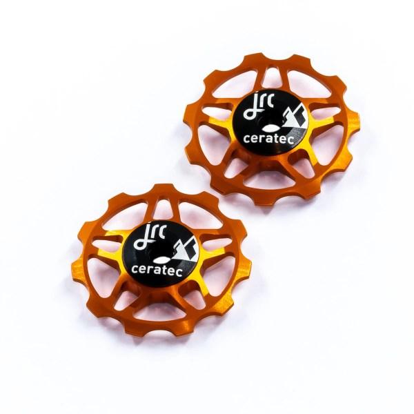 Kółka ceramiczne przerzutki JRC Components 11T do 9/10/11 Sram/Shimano/Campagnolo - pomarańczowe /orange/