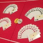 Poker table, texas holdem with card suits laid out