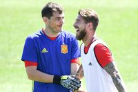 LA ROCHELLE, FRANCE - JUNE 26:  Iker Casillas (L) and Sergio Ramos of Spain share a joke during a training session ahead of their UEFA Euro 2016 round of 16 match against Italy at Complexe Sportif Marcel Gaillard on June 26, 2016 in La Rochelle, France.  (Photo by David Ramos/Getty Images)