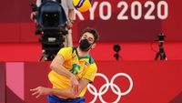 TOKYO, JAPAN - AUGUST 03: Lucas Saatkamp #16 of Team Brazil hits the ball against Team Japan during the Men's Quarterfinals volleyball on day eleven of the Tokyo 2020 Olympic Games at Ariake Arena on August 03, 2021 in Tokyo, Japan. (Photo by Toru Hanai/Getty Images)