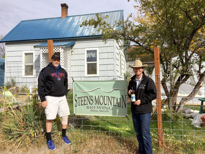 NWFU President Kent Wright greets Rick Roy in front of Steens Mountain Brewing Company.