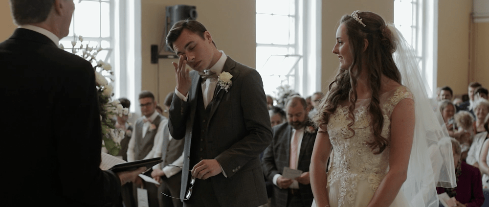 groom crying wedding videographer