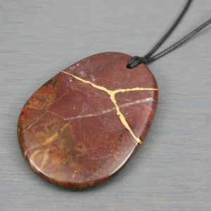 Cherry creek jasper pendant with kintsugi repair on black cotton cord