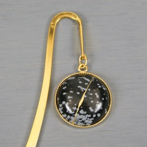 Snowflake obsidian with kintsugi repair on gold plated steel bookmark