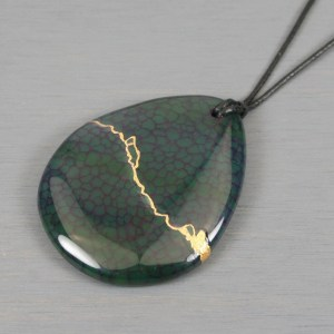 Dark green dragon veins agate teardrop pendant with kintsugi repair on black cotton cord