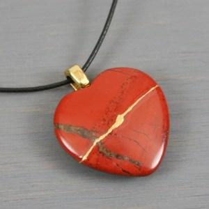 Red jasper broken heart pendant with kintsugi repair on black cotton cord