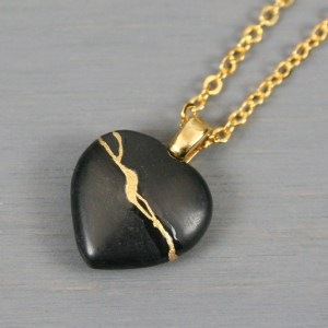 Black stone broken heart pendant with kintsugi repair on cable chain