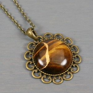 Tiger eye kintsugi pendant in antiqued brass setting on chain