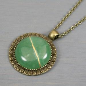 Green aventurine kintsugi pendant in antiqued brass setting on chain