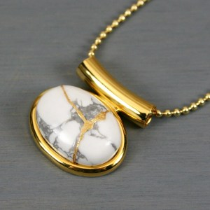 White howlite small oval kintsugi pendant in a gold setting on chain
