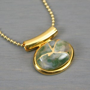 Moss agate small oval kintsugi pendant in a gold setting on chain
