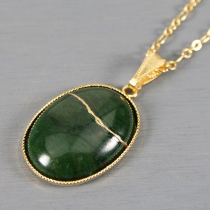African jade oval kintsugi pendant in a gold setting on chain