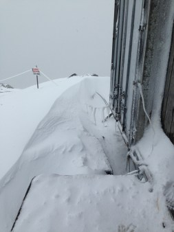 Snow drifts outside the wax conex