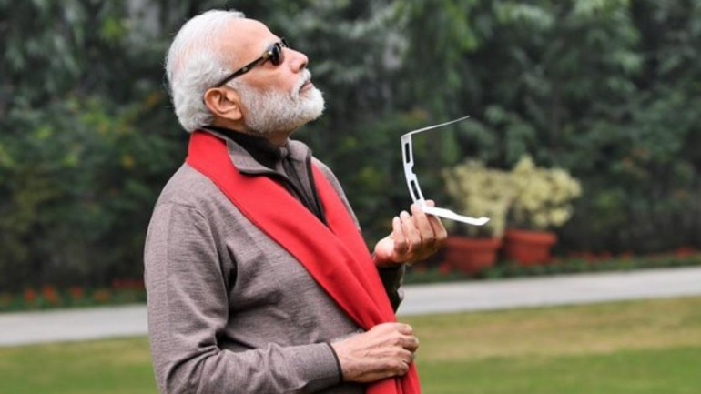 Pm Modi Tweets Picture Of Him Watching The Last Solar Eclipse Of