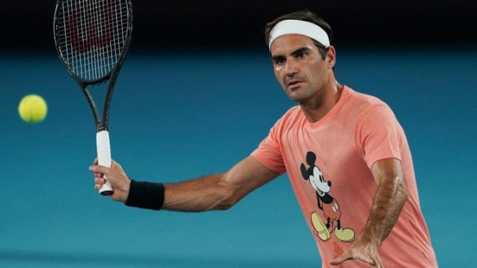 Roger Federer makes a forehand return during a practice session ahead of the Australian Open. (AP Photo)