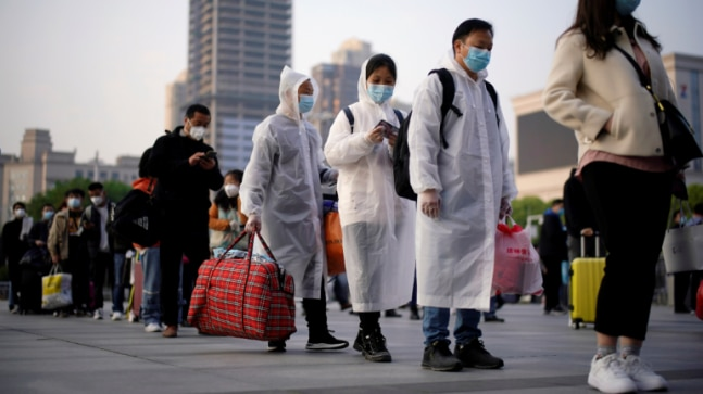 China: Wuhan lockdown ends, but another begins as local coronavirus cases rise