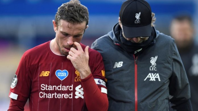 Liverpool's Jordan Henderson and manager Juergen Klopp after Sunday's Premier League match at Everton. (Reuters Photo)