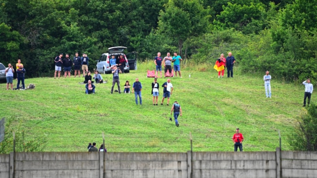 Hungarian GP: Fans brave Covid-19 pandemic to watch the action from hills surrounding Hugaroring