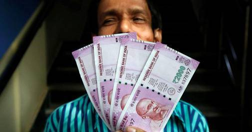 Rupee vs Dollar: Rupee slips 30 paise to 71.94 against dollar amid coronavirus fears