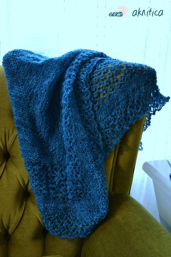 Knitting chair.  Rock Island Shawl, unblocked.  Bliss.