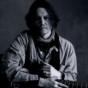 Johnny Depp Signs Paul McCartneys Lyrics In My Valentine