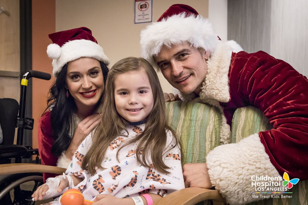 Katy Perry and Orlando Bloom visit children's hospital dressed as Mr. and Mrs. Claus