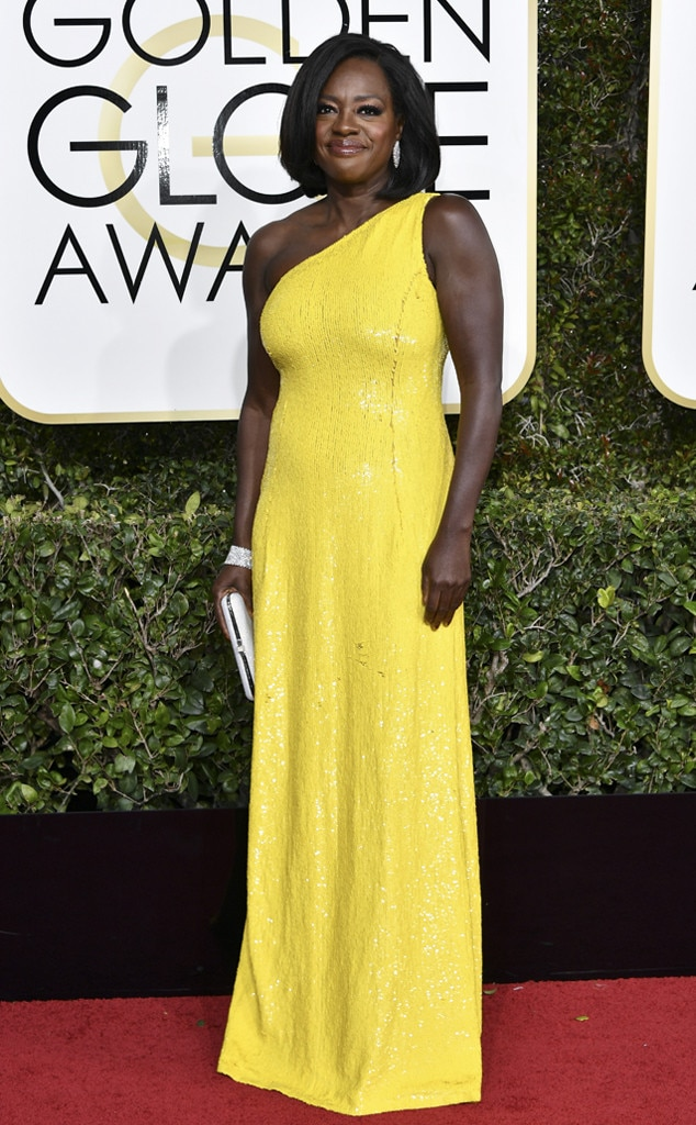 Viola Davis is flawless in everything, from Fences (SEE IT), to introductory speeches (I repeat my request that she make radio speeches weekly for the next 4 years to keep us steady), to this one-shoulder canary yellow gown. You can seldom go wrong pairing a vibrant color with a streamlined style and beautiful - but minimal - accessories. Also it would be a crime to cover up those arms.