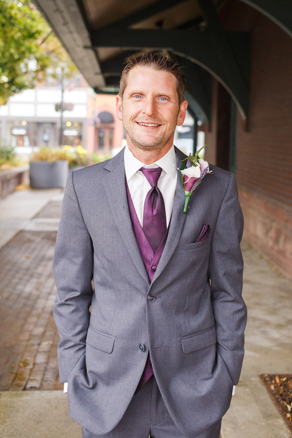 Groom in purple and grey