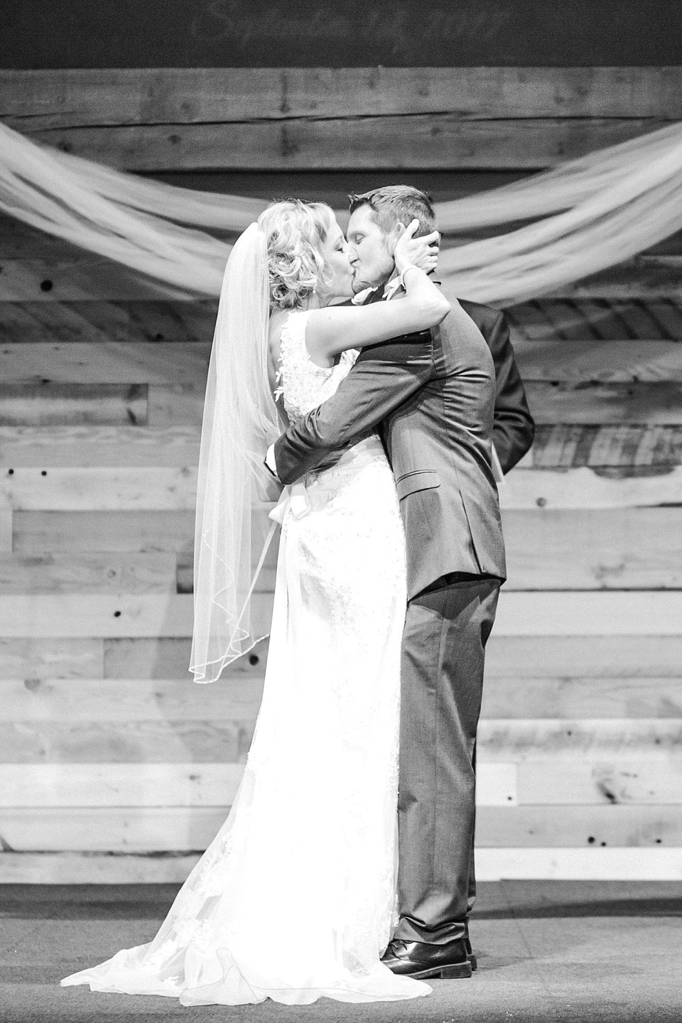 Black and White first Kiss at a Sanctuary Event Center in Fargo, ND wedding