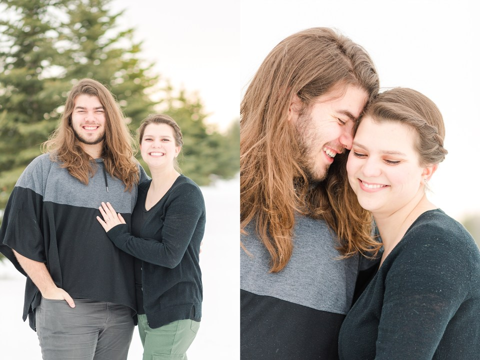 Man and women nuzzle together in the cold winter during their engagement photos