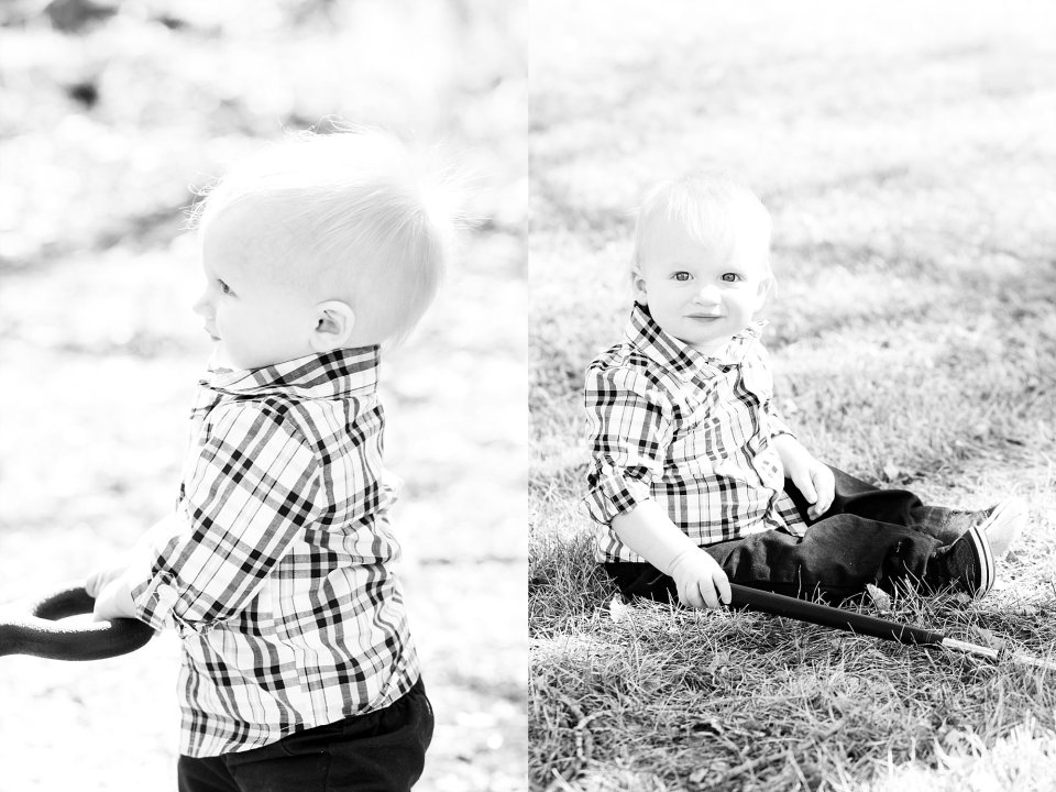 First Birthday boy plays in the grass with wagon handle