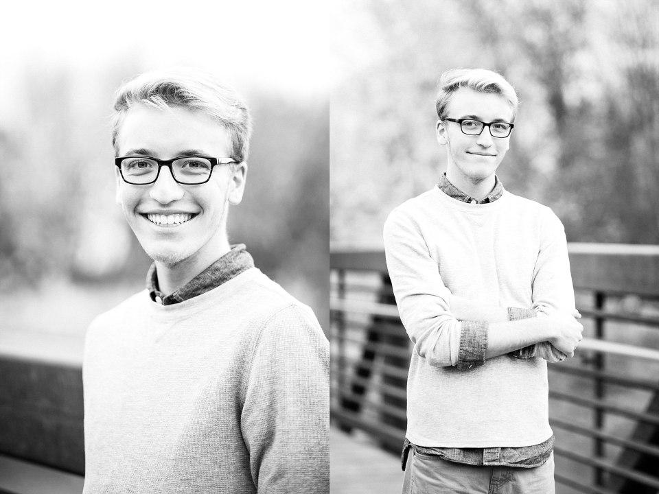 Senior guy in glasses smiles on the Lindenwood bridge in the fall