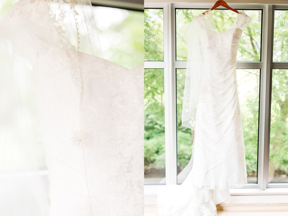 Wedding dress with cap sleeves hangs in front of a window