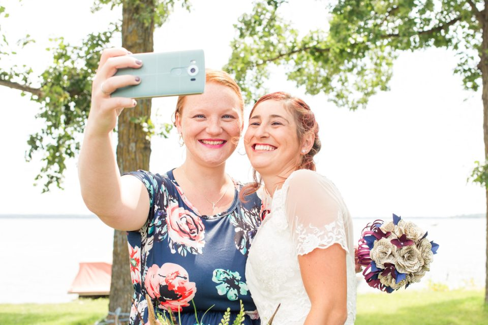 Bride and Bridesmaid smile for a picture after following the suggestion to empty your pockets
