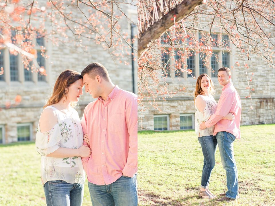 An engaged couple in shades of pink enjoy the spring blossoms outside a Downtown Fargo church