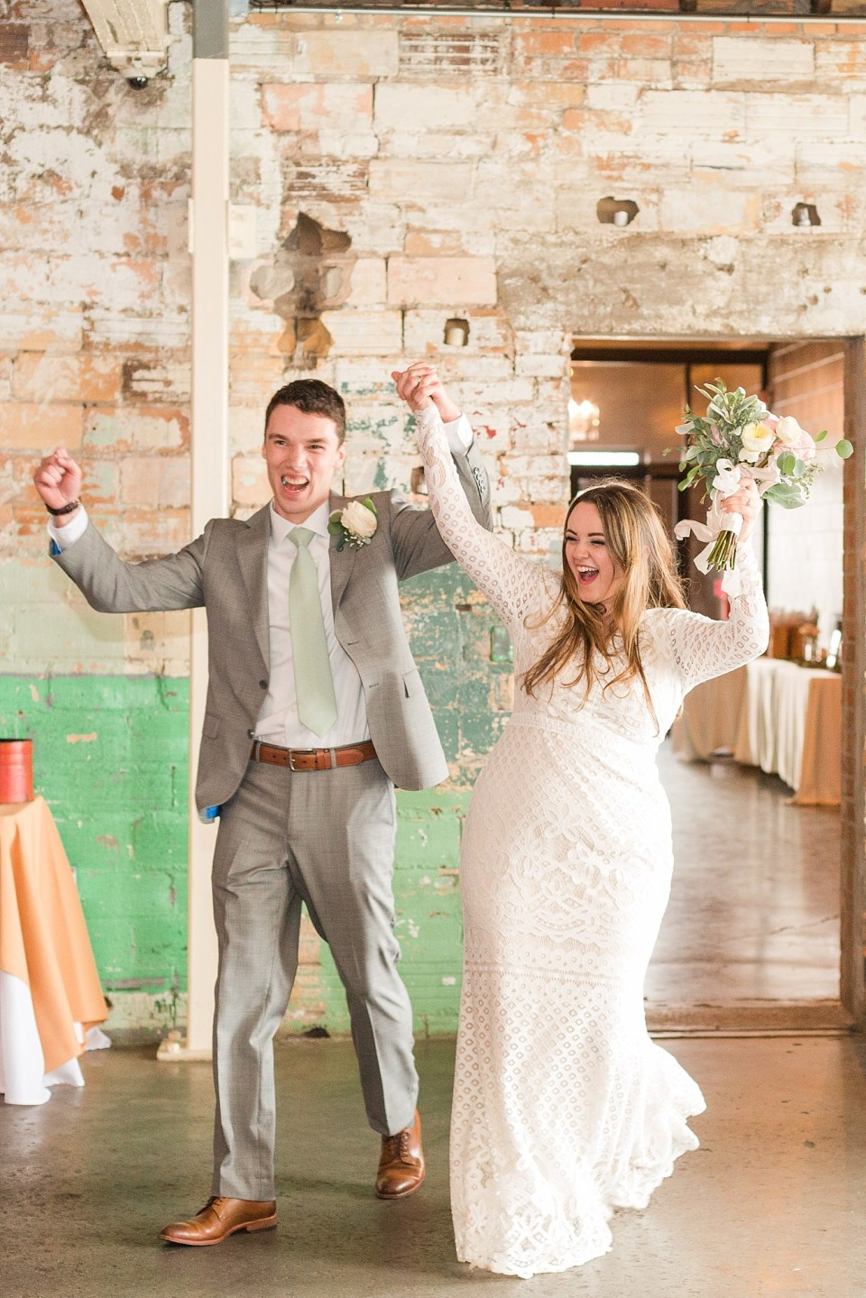 A newlywed couple dances into their wedding reception