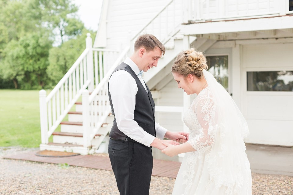 A bride and groom see each other for the first time during their Fargo wedding