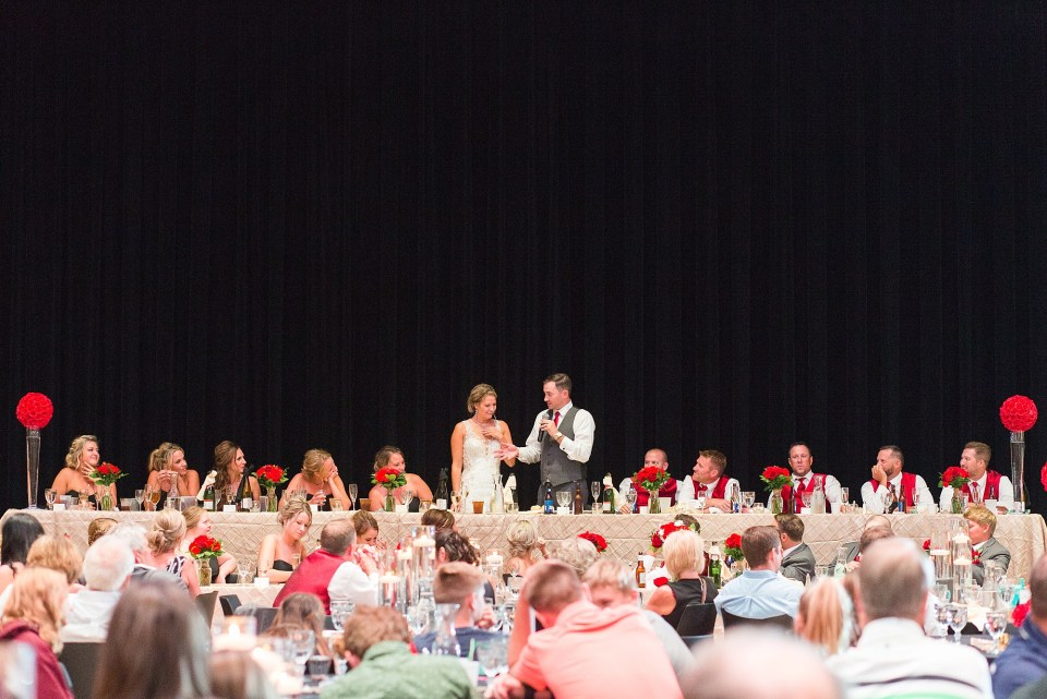 A large head table during speeches at a Glamorous Wedding at the Avalon