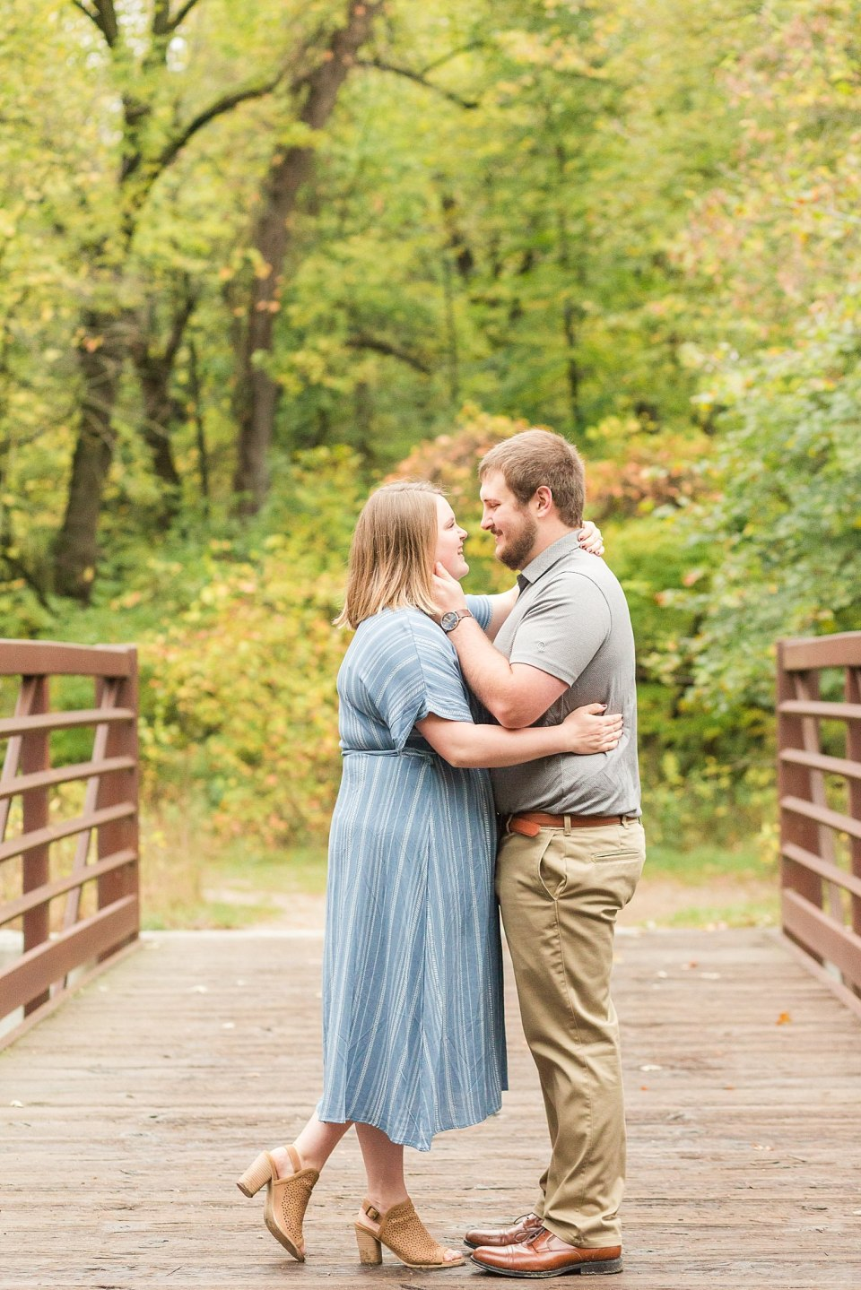 An engaged couple stands on the Buffalo River State Park bridge