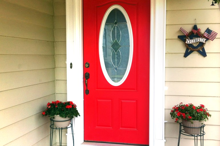 Red impatiens frame the front entry.
