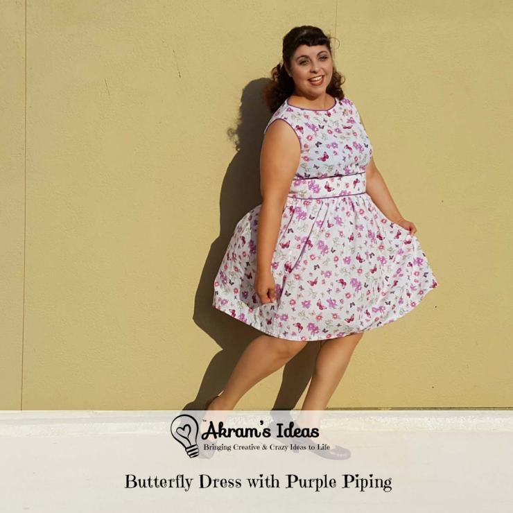 Butterfly dress with purple piping made from vintage 1960s reproduction Simplicity 1364 blouse and gathered skirt in a cotton butterfly print.