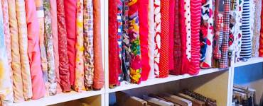 Learn how to organize your fabric stash using a few bookcases and free cardboard.